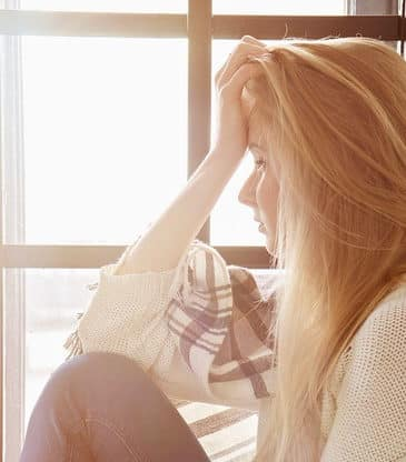 portrait of young blonde woman thinking indoor horizontal