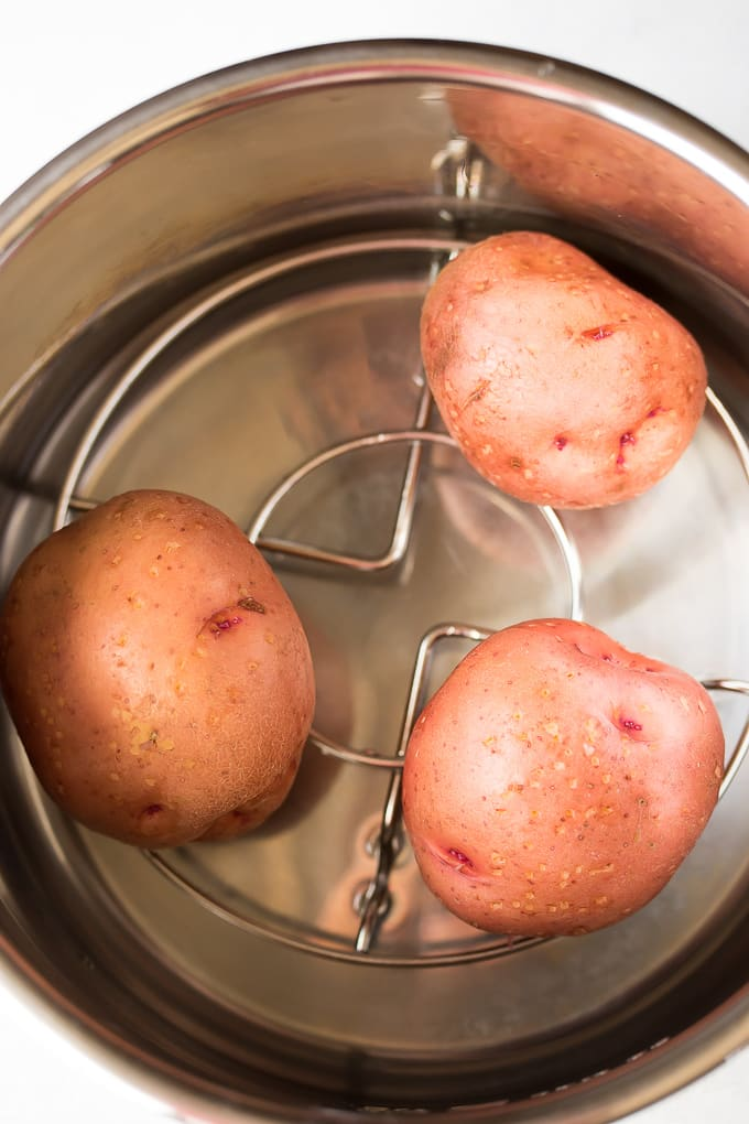 instant pot red potatoes in the pot with the trivet