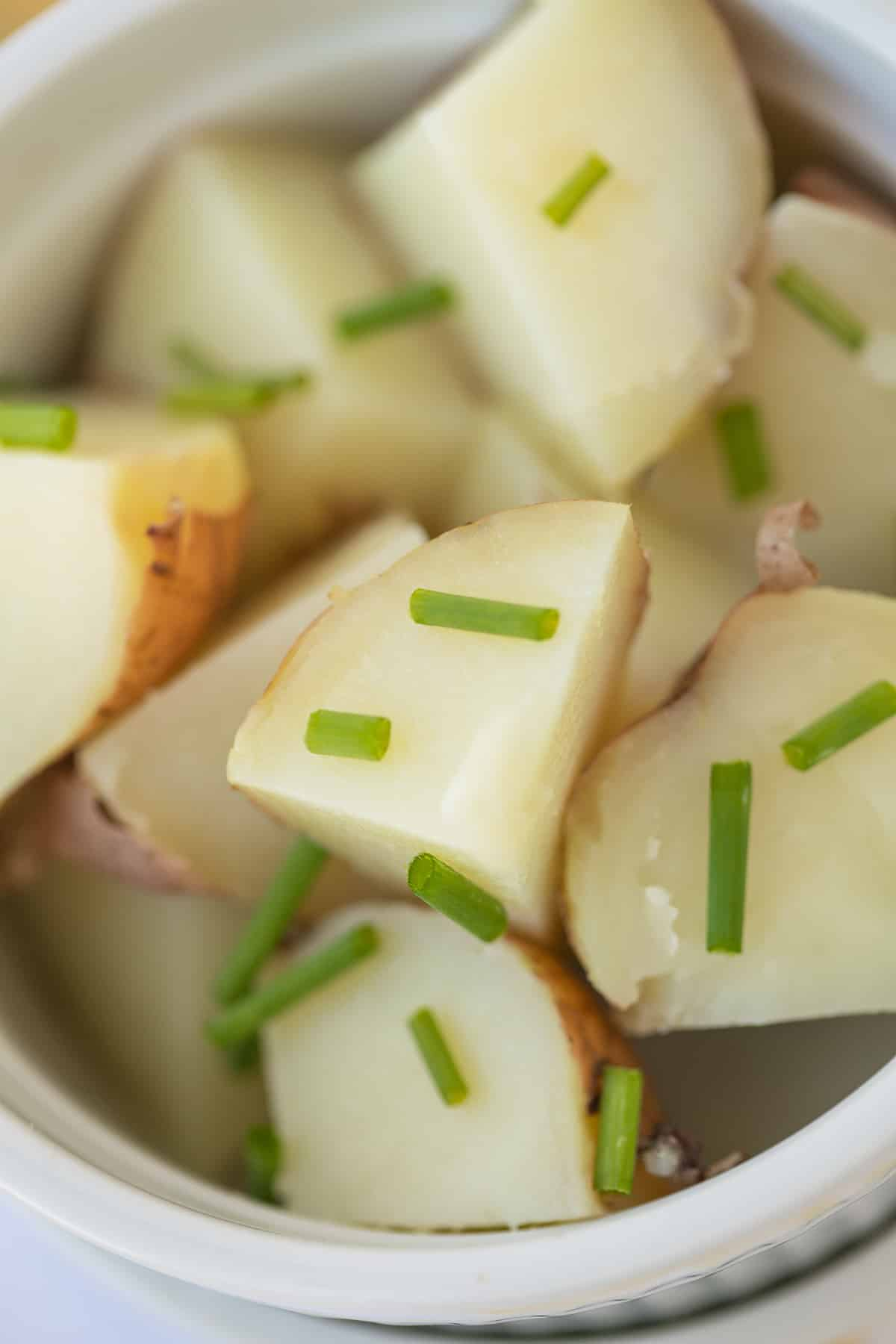 sliced red potatoes in a white bowl