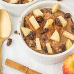 bowl of apple cinnamon steel cut oats with a gold spoon