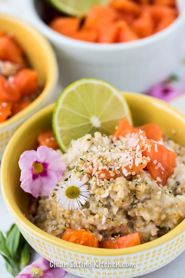 instant pot tropical steel cut oats in bowl with flowers and lime