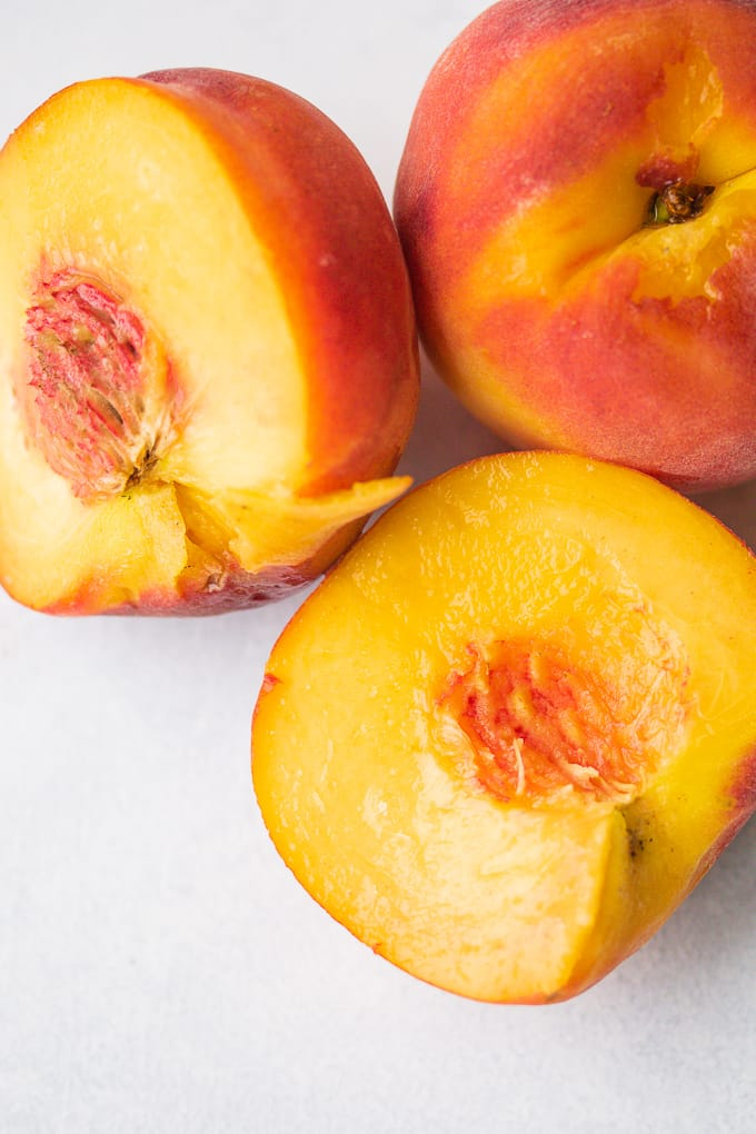 yellow peaches sliced in half