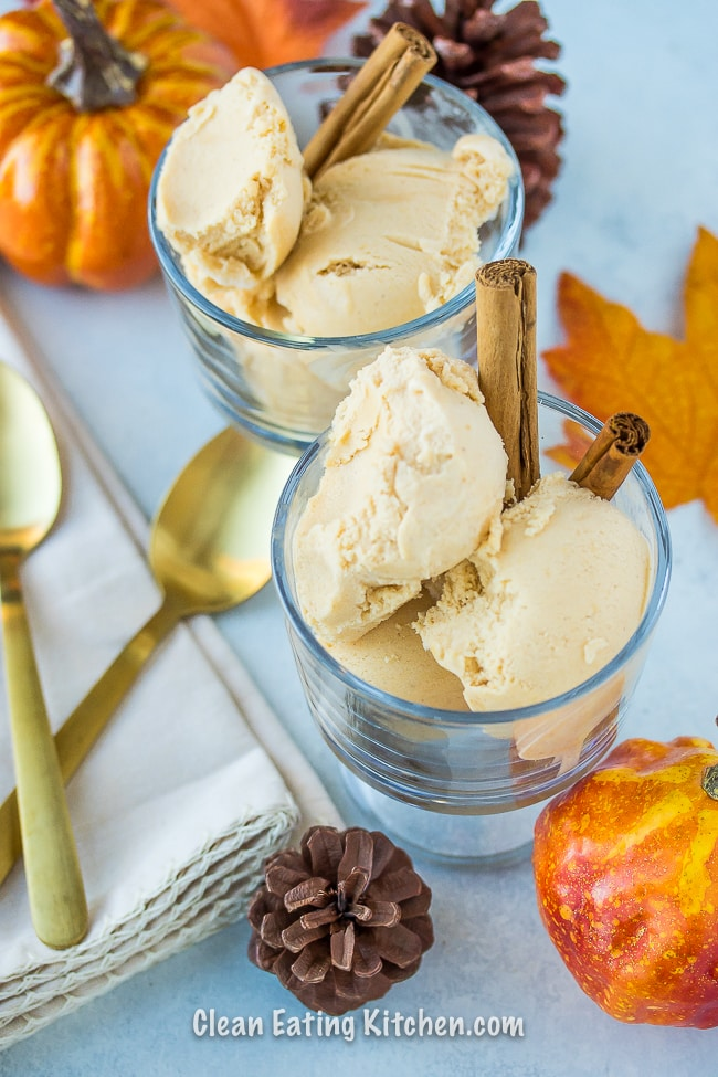 vegan pumpkin ice cream in glass serving dishes with cinnamon sticks