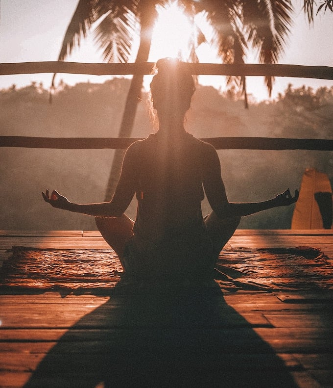woman meditating after yoga