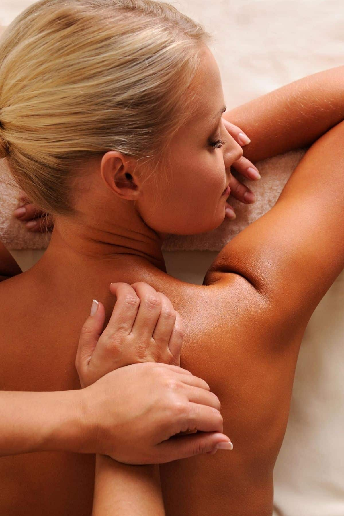 blond woman getting a massage