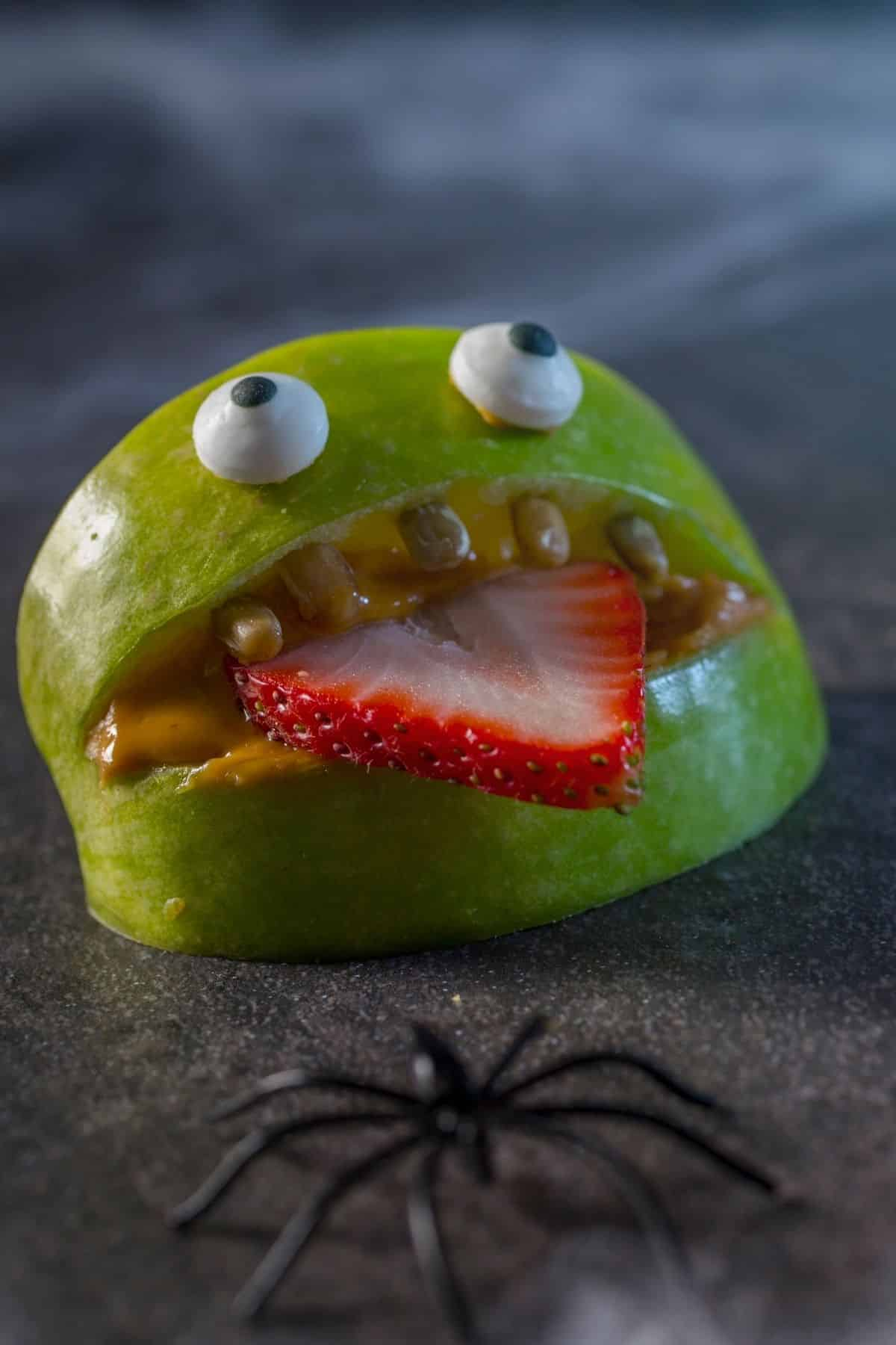 funny face made using an apple and strawberry