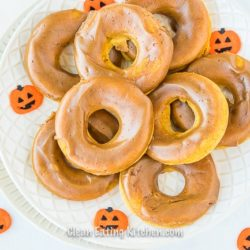 gluten free pumpkin spice baked donuts with pumpkin stickers