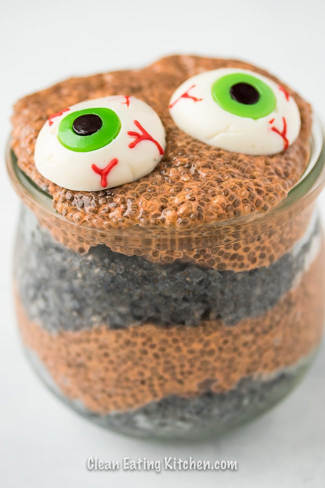 orange and black chia pudding with scary gummy eyes