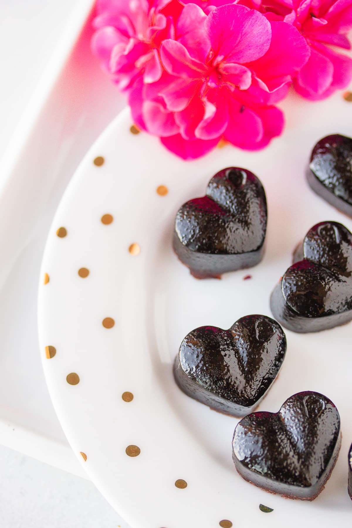 cbd heart gummies on a plate with fresh flowers
