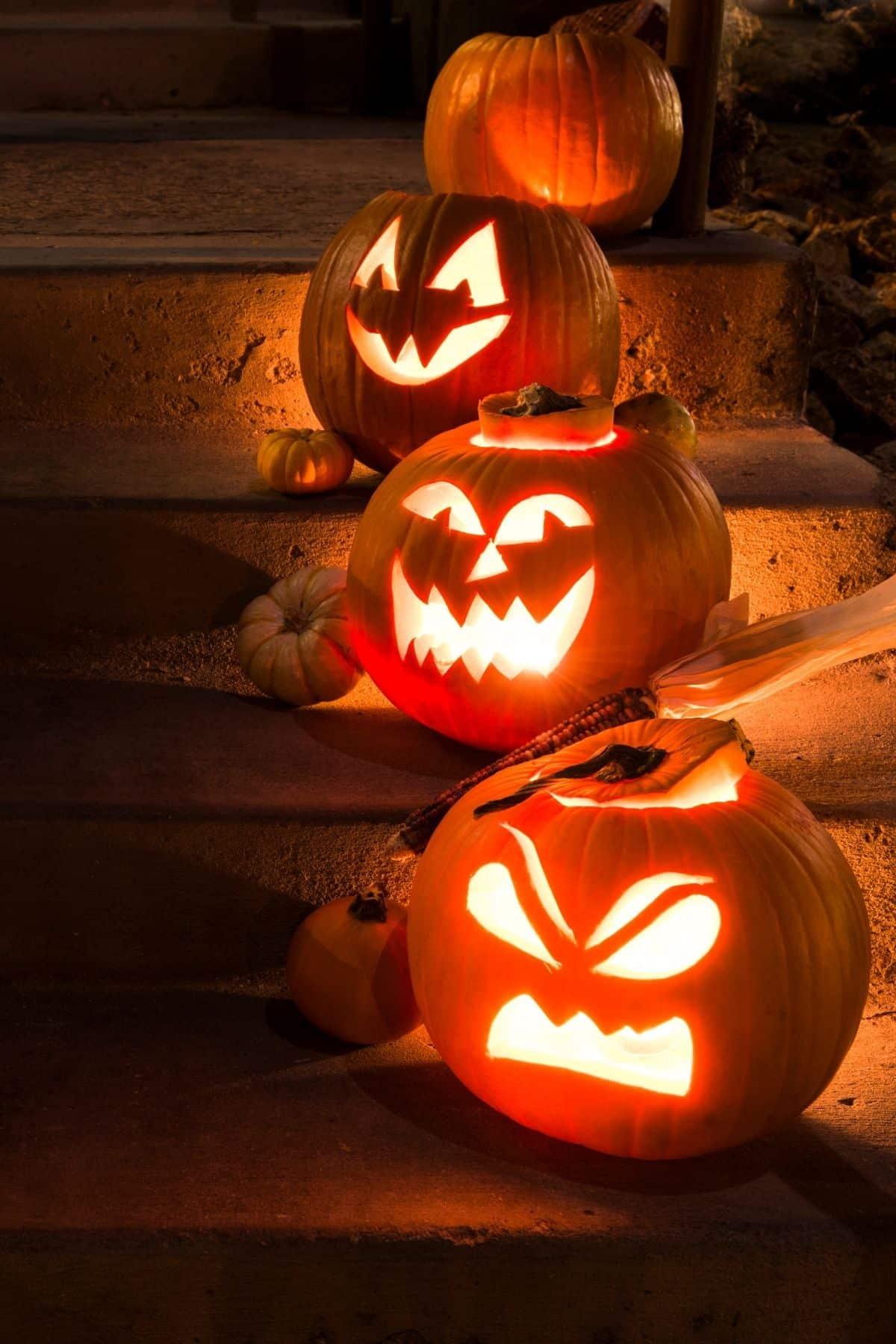 three jack o'lanterns on a porch