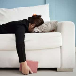 woman laying on a couch facedown