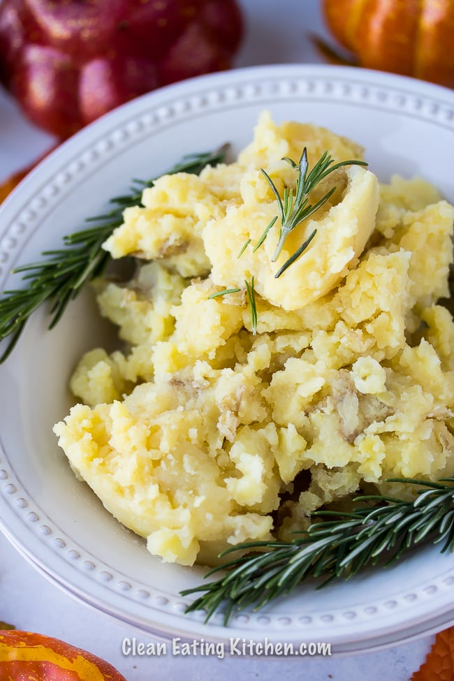 instant pot mashed potatoes with fresh rosemary sprigs