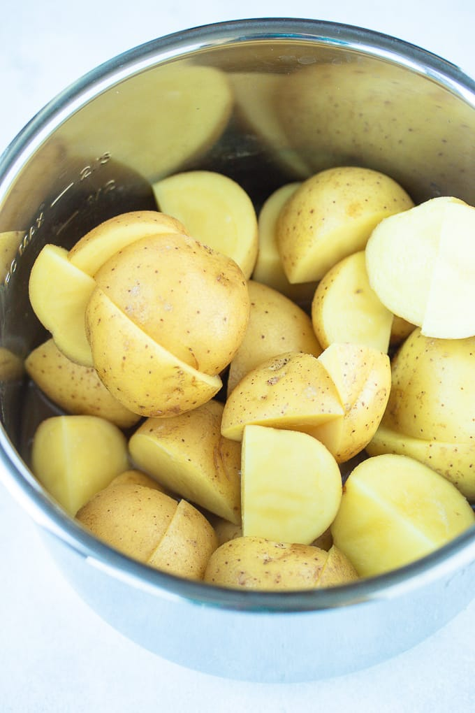 white potatoes cut in half ready to be cooked