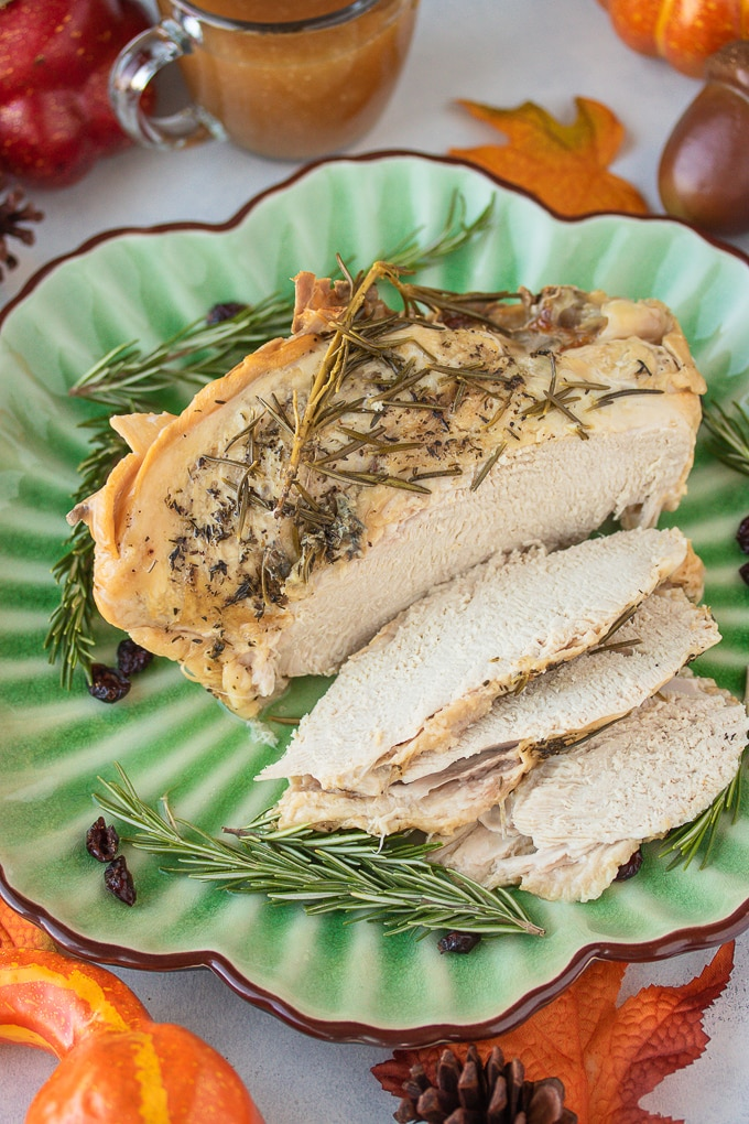sliced turkey breast on a plate with gravy