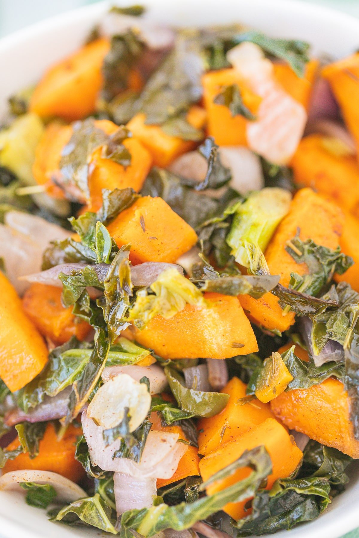 bowl of sweet potatoes and kale