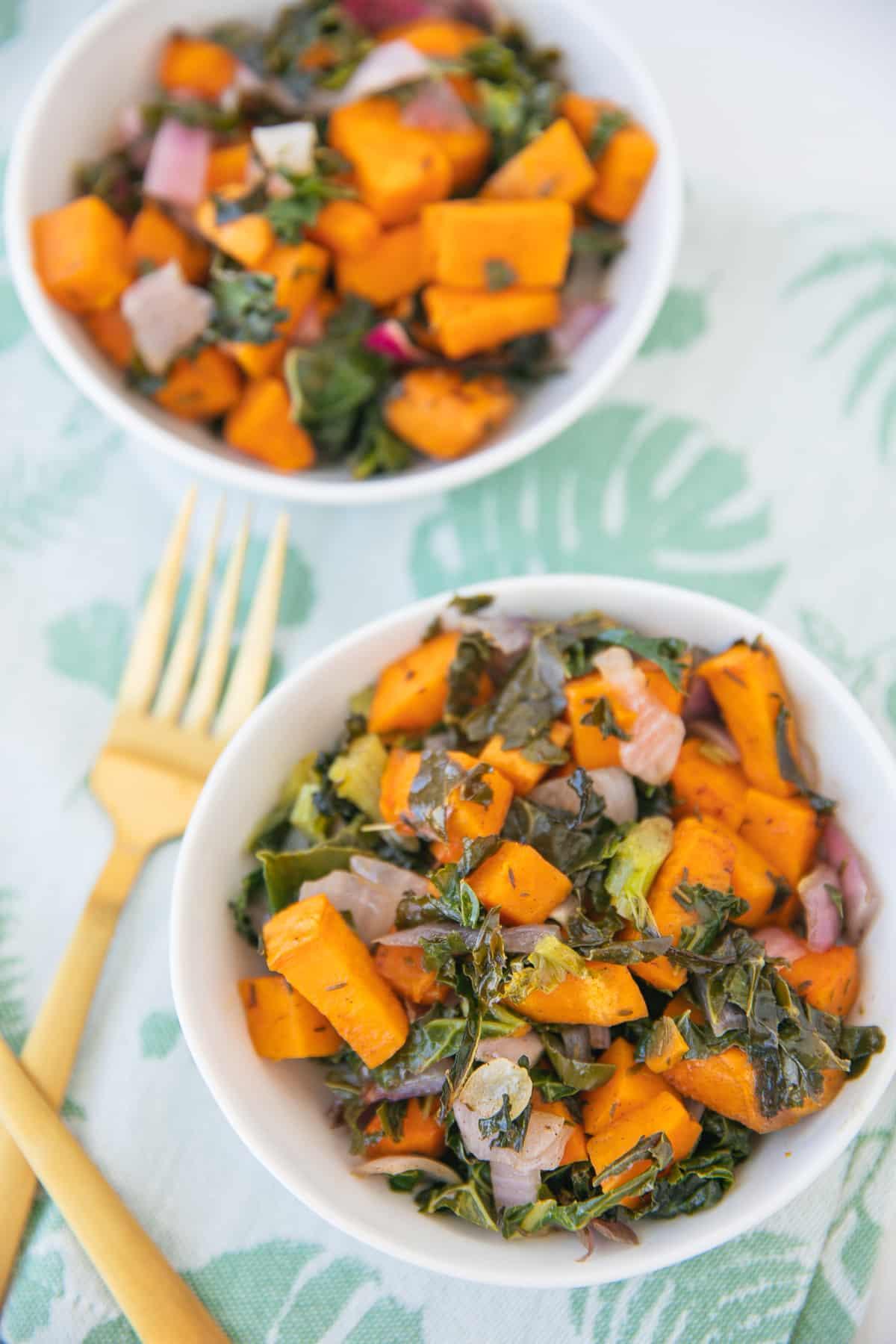 two bowls of kale sweet potato casserole