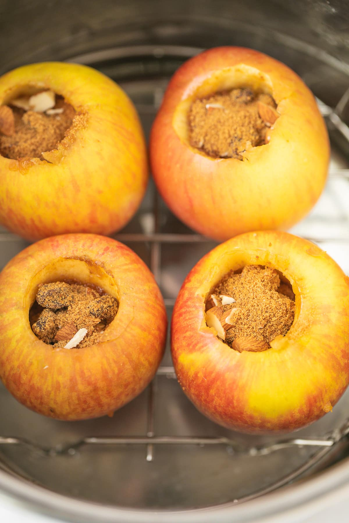 apples in instant pot with filling ready to be baked