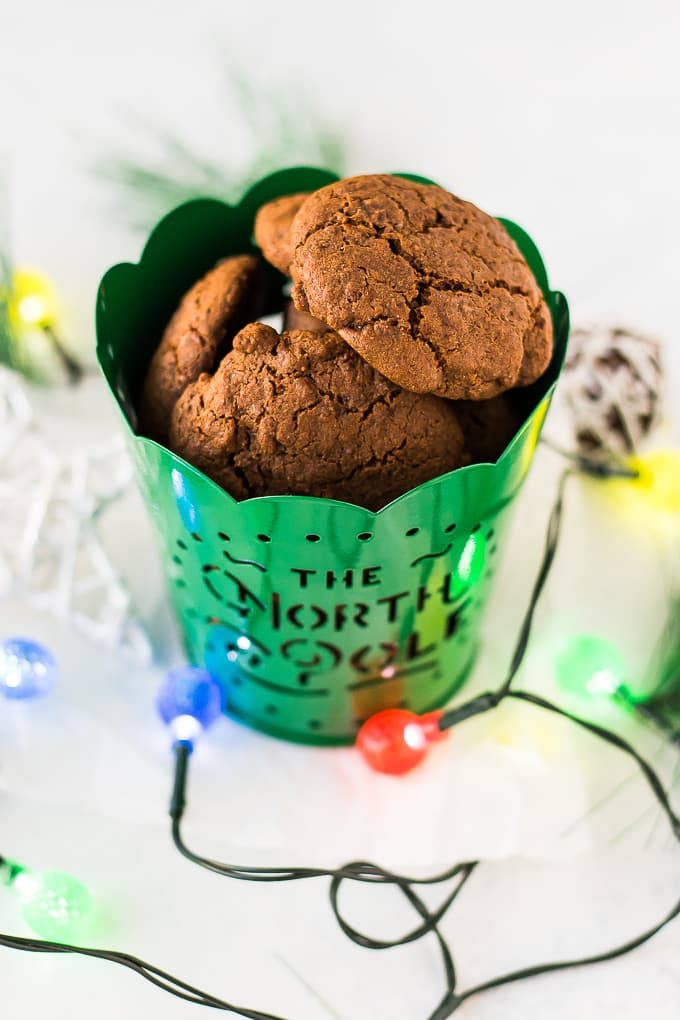 vegan molasses cookies in a north pole green tin