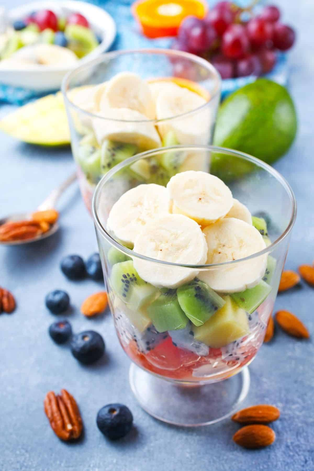 collection of fresh fruits in parfait glasses