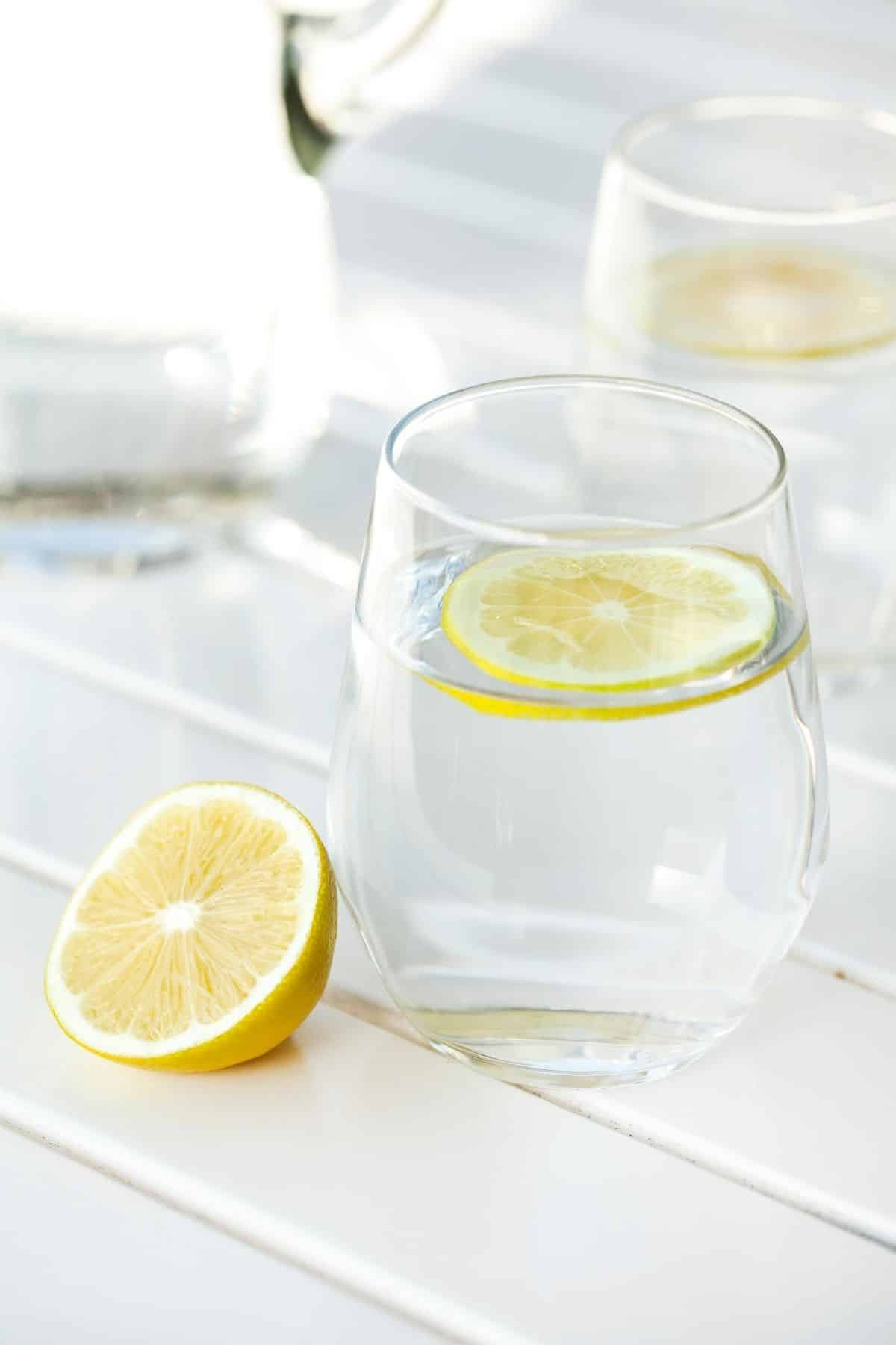 glass of water served with fresh lemon
