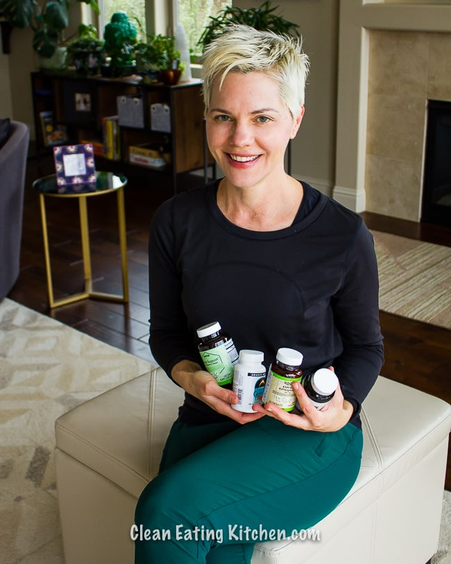 carrie in black shirt with supplements in hands