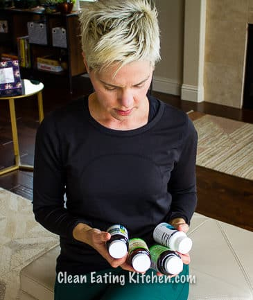 carrie looking at supplements in hands