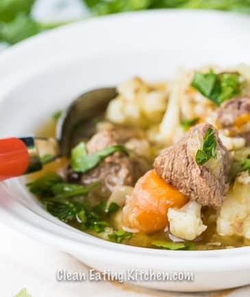 instant pot beef stew with orange spoon