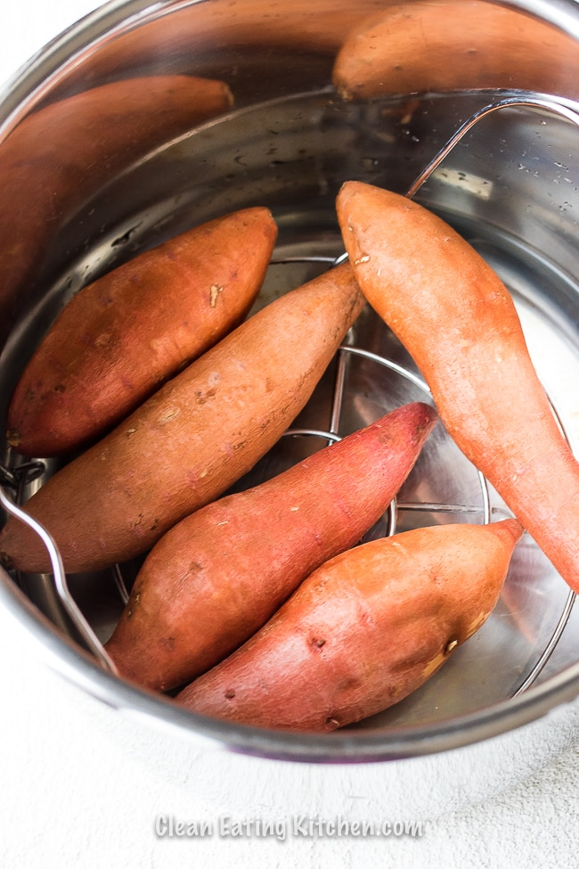 instant pot sweet potatoes whole on trivet in Instant Pot