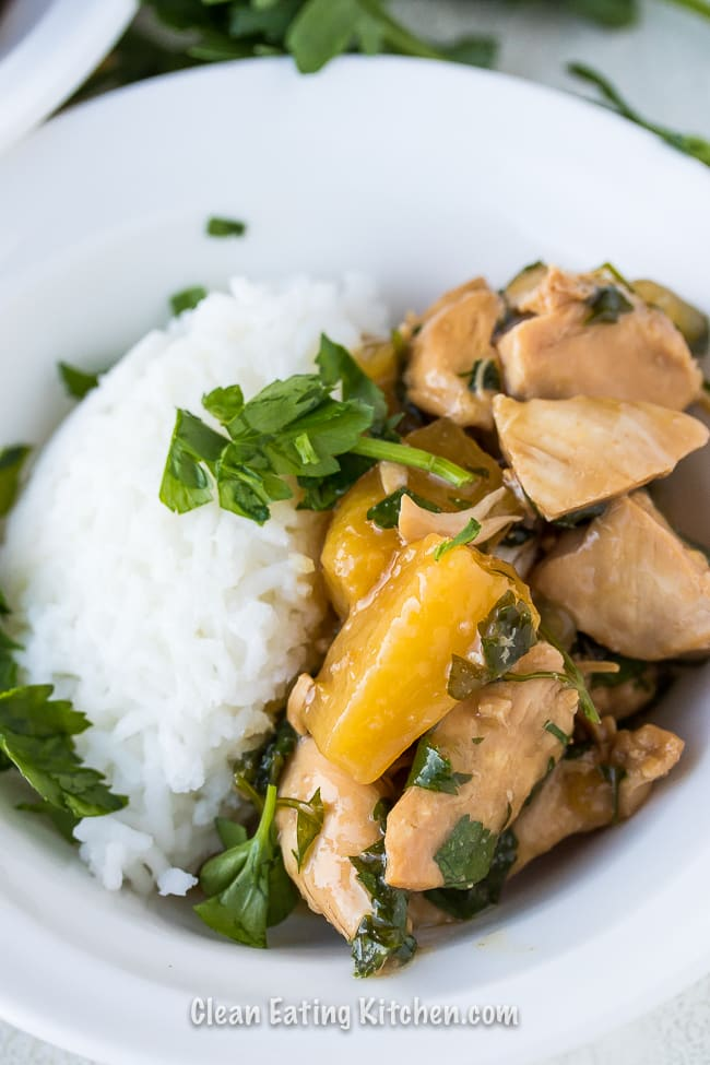 instant pot teriyaki chicken in white bowl with rice and parsley