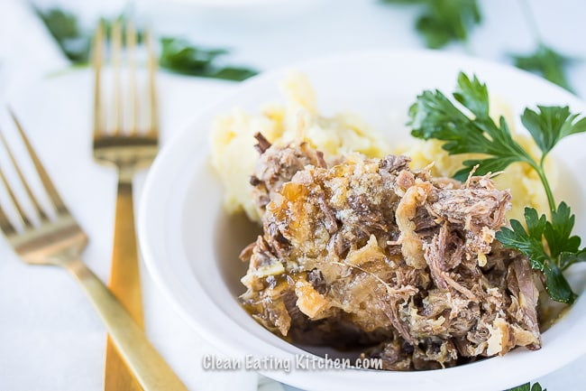 slow cooker corned beef and cabbage with gold forks