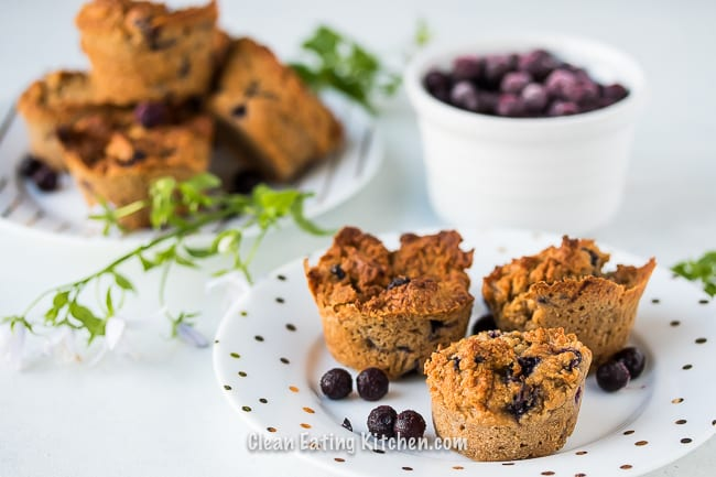 air fryer blueberry muffins on two white plates
