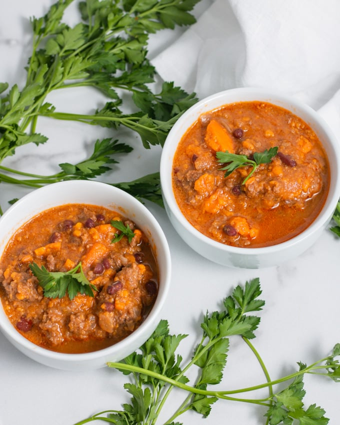instant pot beef sweet potato chili in two bowls