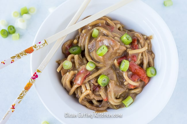 instant pot noodles gluten free in white bowl with chopsticks and green onions