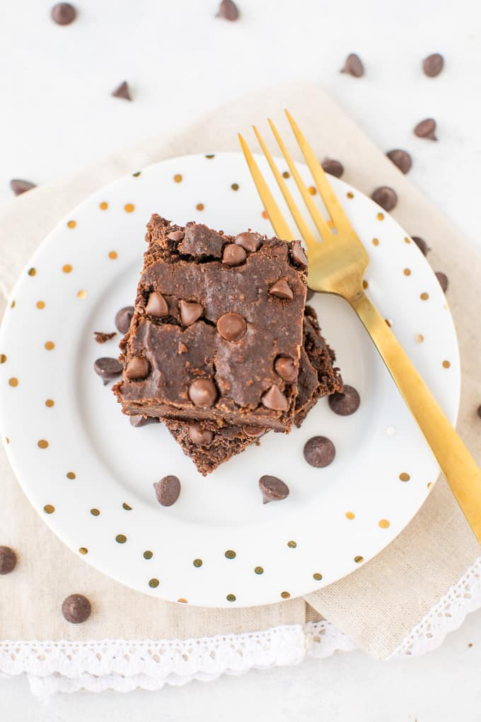 brownies on a plate with polka dots and a gold fork