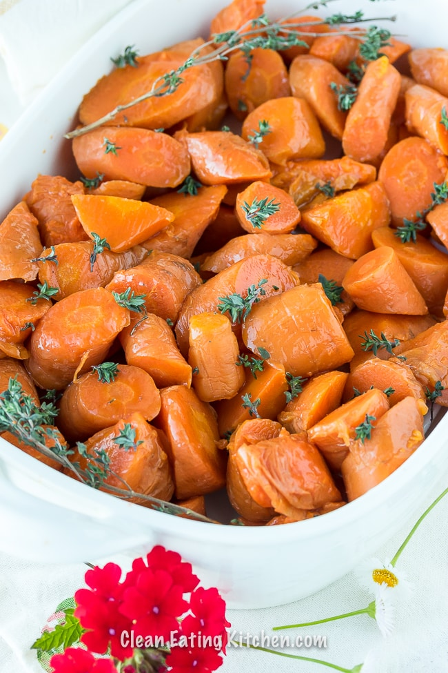 instant pot carrots in white serving dish with flowers up close