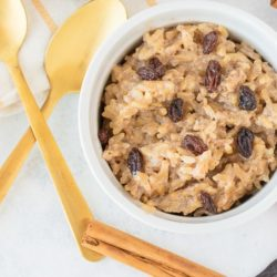 bowl of pudding with raisins on top