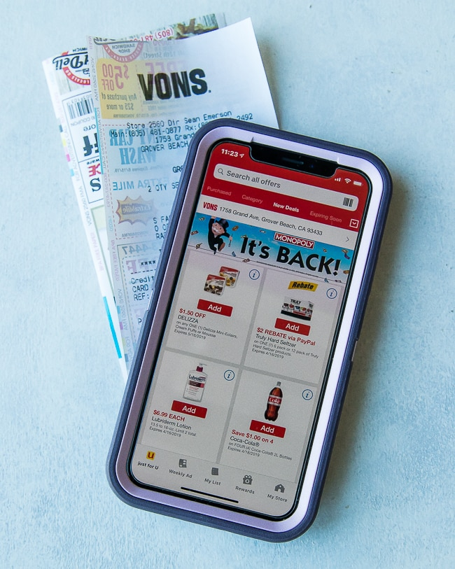 vons app coupon page on iPhone with vons receipt behind