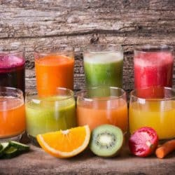 fresh juices lined up on a countertop
