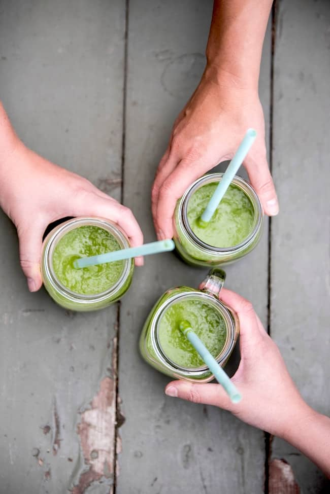 friends sharing green juice