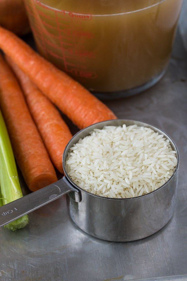 white basmati rice with carrots in background