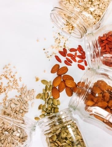 nuts and seeds in glass jars
