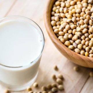 soy beans and soy milk in glass