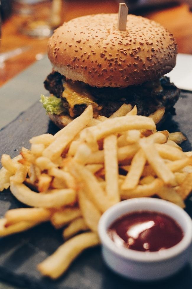 Hamburger and fries with ketchup