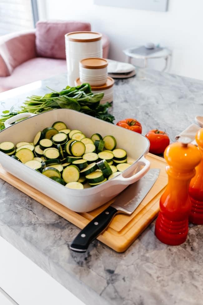 Chopped veggies in a casserole dish
