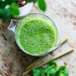 Green smoothies on table