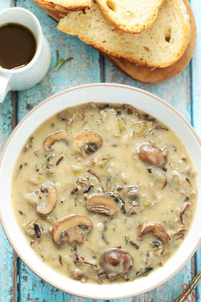 Instant pot mushroom and rice soup served in a white bowl