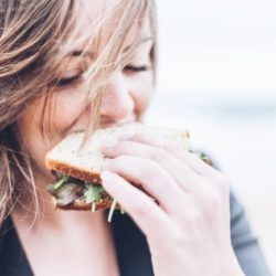 A woman eating a sandwich