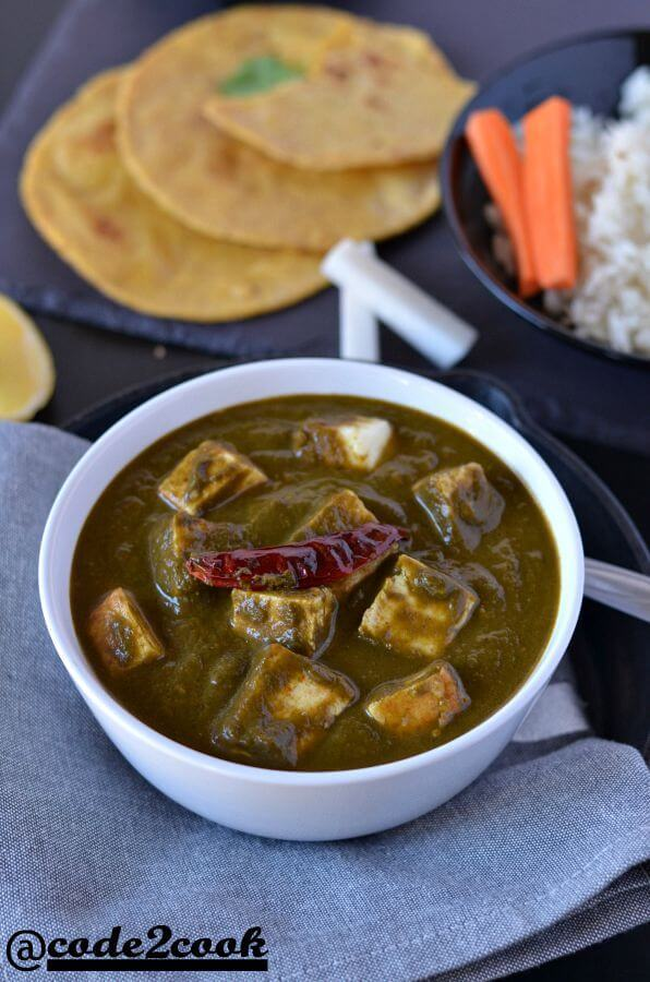 Instant pot palak paneer served in a white bowl