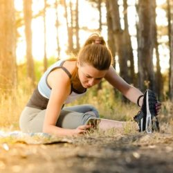 young woman stretching before a run
