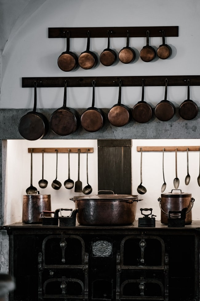 Copper Cookware hanging on wall in kitchen